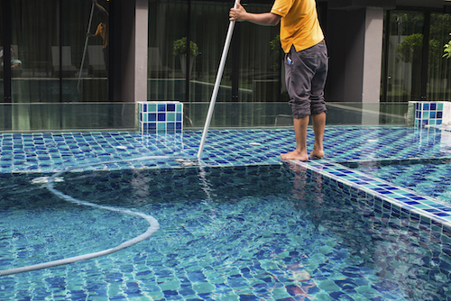 A man that is offering pool cleaning services in Englewood, FL